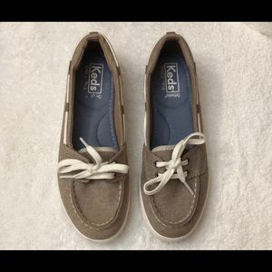 Keds sneakers, slip on with shoelace.